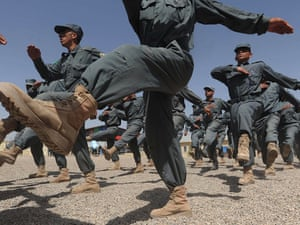 Afghan National Police (ANP) personnel march during a graduation ceremony at a police training centre in Herat this morning.