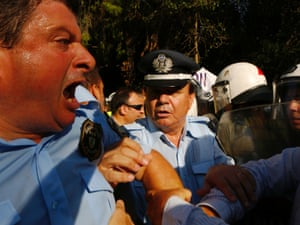 Greek policemen and members of police unions clash with riot police outside a riot police facility in Athens September 6, 2012.