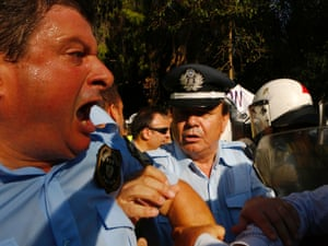 Tempers flare as Greek policemen clash with riot police outside the riot police HQ in Athens.