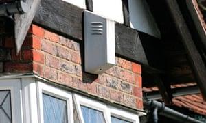 A burglar alarm box on a house
