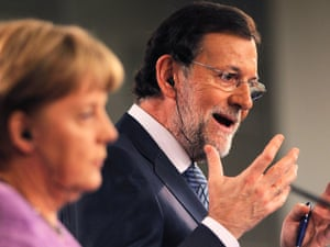 Germany's Chancellor Angela Merkel, left,  and Spain's Prime Minister Mariano Rajoy, right, gesture during a press conference at the Moncloa Palace, in Madrid, Spain, Thursday, Sept. 6, 2012.