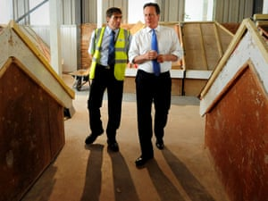 David Cameron with roofing instructor Ian Stott during a visit  to the National construction college at King's Norton, Birmingham.