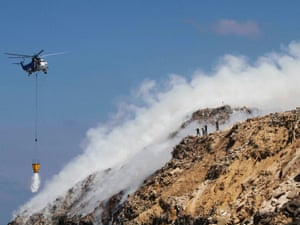 A Lebanese Army helicopter tries to extinguish the fire.