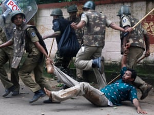A demonstrator is taken away by Indian riot policemen during a violent protest in Bhubaneswar.  Dozens were injured as police fired teargas and charged crowds during a Congress party rally demonstrating against India's Odisha state government.