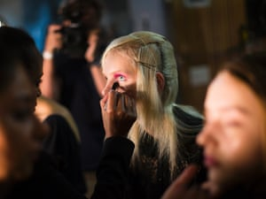 A model has eye make-up applied backstage before the Creatures of Wind Spring 2012 collection is shown during Fashion Week in New York,today.