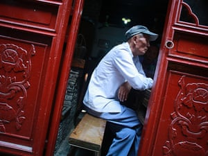 Afternoon tea? A man sits at an old tea house in Shanghai, China, today.
