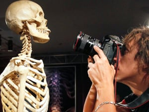 Meet your ancestor: a Ukrainian photographer takes photographs of a skeleton on the day before the official opening of 'The Human Body' exhibition in Kiev, Ukraine today.