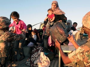 Syrian refugees are pictured at the al-Thunebah village on Jordan-Syria border.