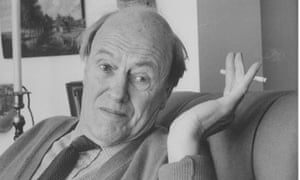 Roald Dahl pictured waving a cigarette in conversation at home