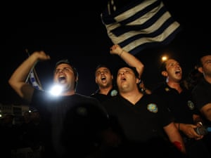 Coast guards shout slogans during a protest against budget cuts  in Athens, on September 6, 2012.  Nearly 2,000  policemen, coast guards  and firefighters continued their protests against planned salary cuts, as security forces summoned from around the country attended an evening demonstration on Thursday in Athens.