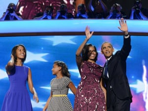 US President Barack Obama, First Lady Michelle Obama, daughters Malia (L) and Sasha (2nd-L) wave after Obama's nomination acceptance speech at the Time Warner Cable Arena in Charlotte, North Carolina, on September 6, 2012 on the final day of the Democratic National Convention.