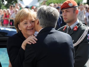 Germany's Chancellor Angela Merkel is welcomed by Austrian Chancellor Werner Faymann on September 7, 2012 during her visit to Vienna.