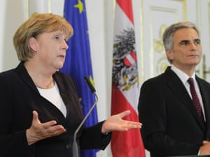 Austrian Chancellor Werner Faymann (R) and German Chancellor Angela Merkel brief the media during a news conference in the Chancellor's office in Vienna September 7, 2012.