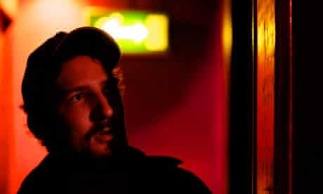 Frank Turner waits in the shadows before going on stage