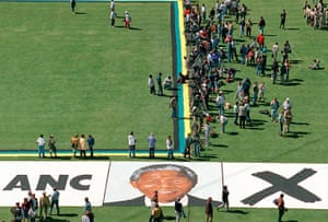 Apartheid gallery: Portrait of Nelson Mandela is on the grass at Soweto football stadium