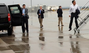 Republican presidential candidate Mitt Romney gets off his campaign aircraft in Sergeant Bluff, Iowa.