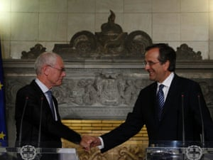 Greece's prime minister Antonis Samaras (R) shakes hands with visiting European Council chairman Herman Van Rompuy during a press conference in Athens September 7, 2012