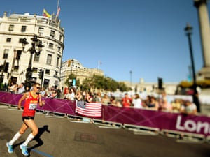 T46 runner Frederic van den Heede of Belgium runs into Trafalgar Square during the  men's marathon