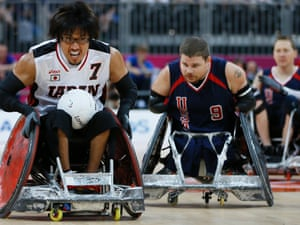 Daisuke Ikezaki of Japan is chased by Nick Springer of the United States in their bronze medal wheelchair rugby match