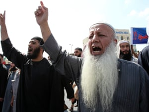 Members of the Islamist Salafis shout slogans during a demonstration in front of the prime minister's office in Amman, on 9 September. The demonstration was organized to call for the release of dozens of their groups held in Jordanian, Syrian and Iraqi prisons.