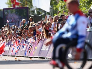 Crowds on The Mall cheer David Weir as he receives his gold medal