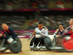 Shin Nakazato of Japan bursts through the United States' defence during the mixed wheelchair rugby bronze medal match.
