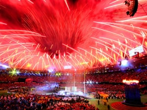 Fireworks illuminate the stadium.