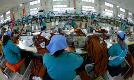 Chinese garment factory workers prepare products for export