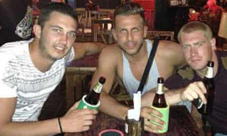 Stephen Ashton (centre) on holiday in Thailand where he was shot dead at a New Year's Eve party