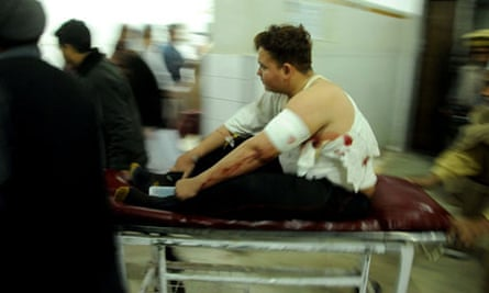 The injured driver of the van carrying the aid workers is rushed to a hospital in Peshawar, Pakistan