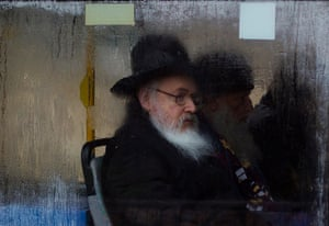 Snow in Jerusalem: An ultra-Orthodox Jewish man looks out of a fogged up bus window