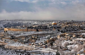 Snow in Jerusalem: Snow covers the Dome of the Rock in Jerusalem's Old City