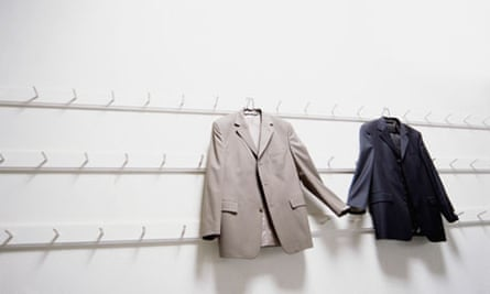 Two suit jackets holding hands