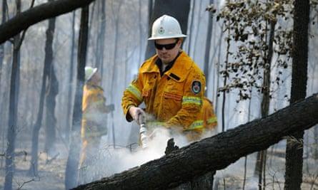 Firefighters douse burning logs near Deans Gap