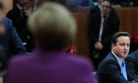 David Cameron looks toward German chancellor Angela Merkel at an EU summit