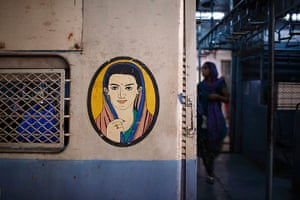 Trains for women: A picture of a woman near the entrance of the female compartment