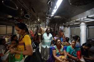 Trains for women: A vendor sells food inside the Ladies' Special train in Mumbai