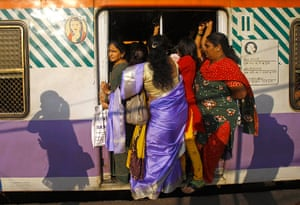 Trains for women: Women stand in the door of the women's compartment of a train