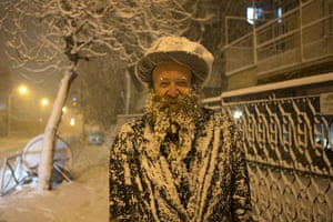 Snow in Jerusalem: An ultra-Orthodox Jewish man covered with snow