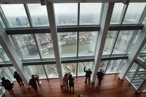 Shard view: Visitors look out at the mist-obscured view of London from the 68th floor