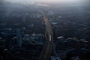 Shard view: Commuter trains at dawn on the approach to London Bridge station