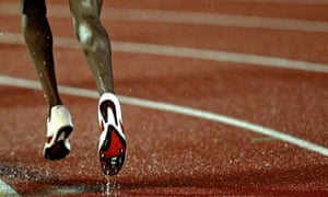 Kenya's Masai runs through a puddle of water during the 5000m men's race in Ostrava