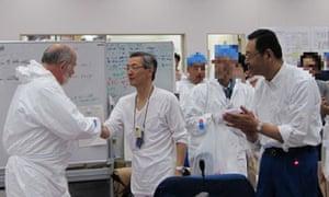 Atsufumi Yoshizawa meets a member of an IEA delegation at Fukushima Daiichi