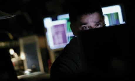 Man working at computer in dark