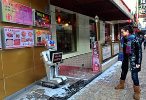 Robot Restaurant: A robot greets people outside a Restaurant