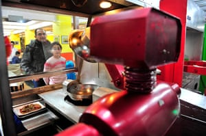 Robot Restaurant: Customers watch a robot cooking dishes at a Robot Restaurant in Harbin