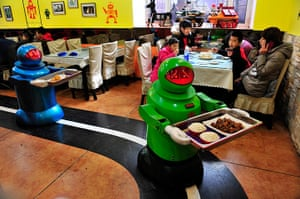 Robot Restaurant: Robots deliver dishes to customers at a Robot Restaurant in Harbin