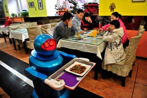 Robot Restaurant: Robot delivers a dish to customers at a Robot Restaurant in Harbin