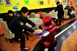 Robot Restaurant: A robot serves a customer with French fries