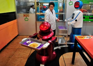 Robot Restaurant: Robot delivers French fries to customers at a Robot Restaurant in Harbin